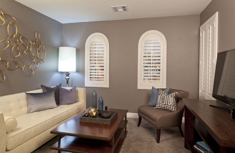 Cleveland family room with arch plantation shutters.