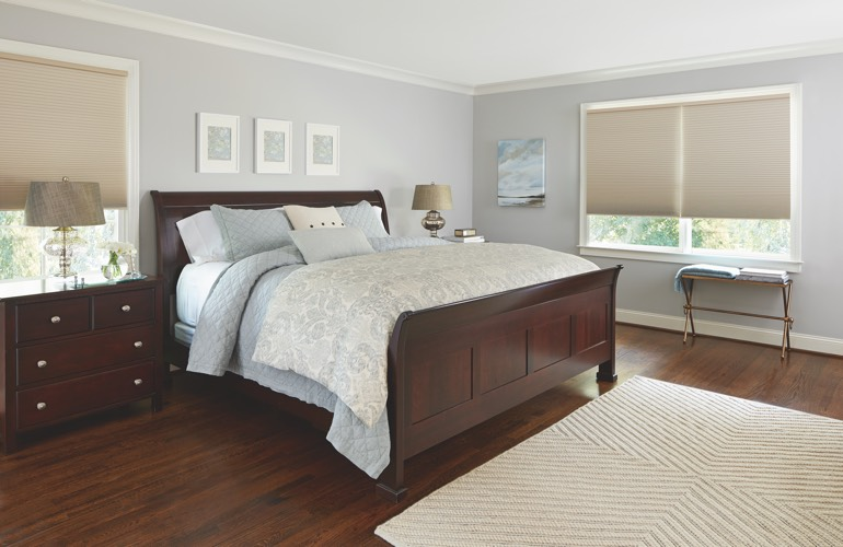 Beige shades in a Cleveland bedroom.