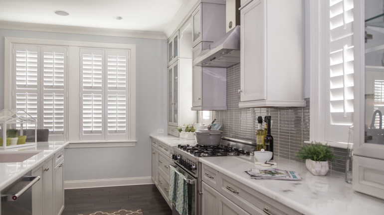 Polywood shutters in Cleveland kitchen with marble counter.