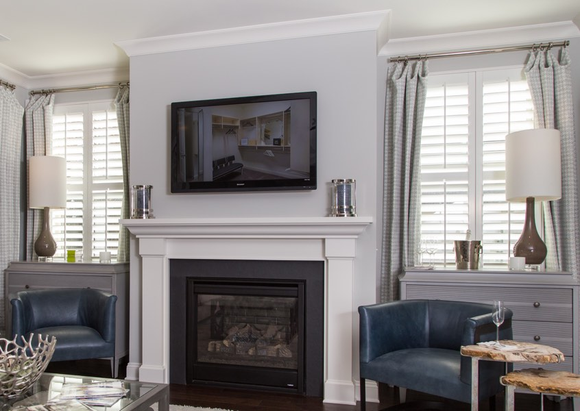 tv room Cleveland faux wood shutters