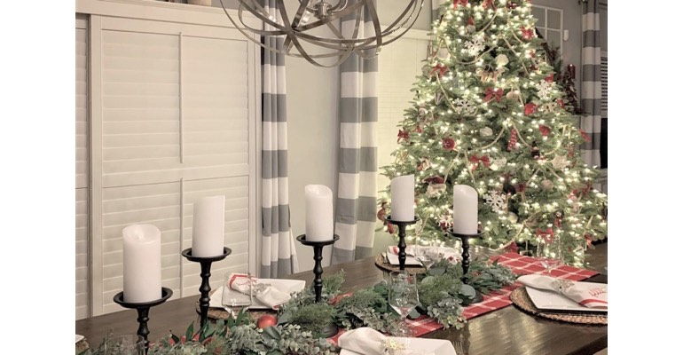 Holiday table in festive dining room.