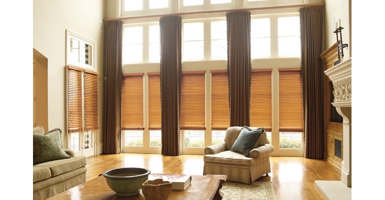 Cleveland great room with wooden blinds and full-length draperies.