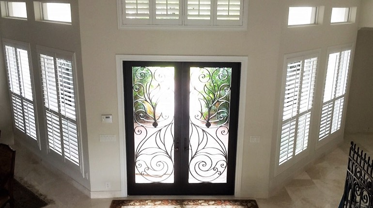 Cleveland foyer with glass doors and indoor shutters