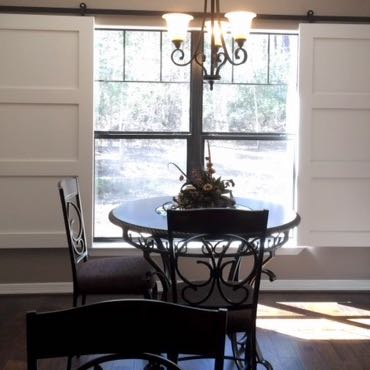Cleveland dining room barn door shutters.