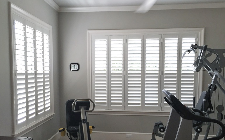 Cleveland home gym with shuttered windows.