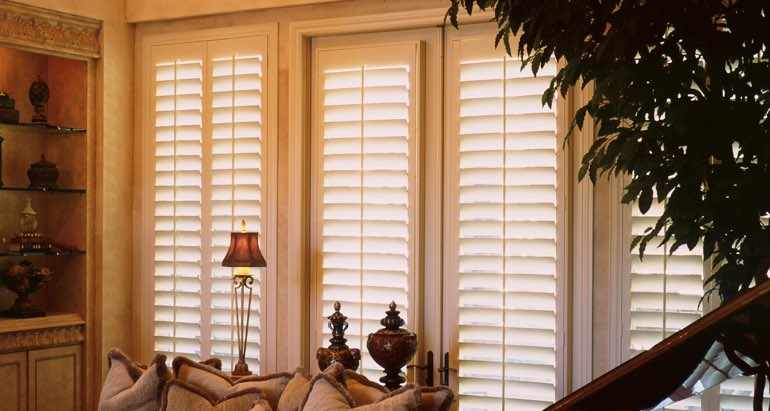 Plantation shutters on windows and door in Cleveland living room