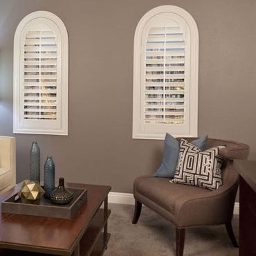 Cleveland family room arched shutters.