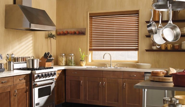 Cleveland kitchen faux wood blinds.