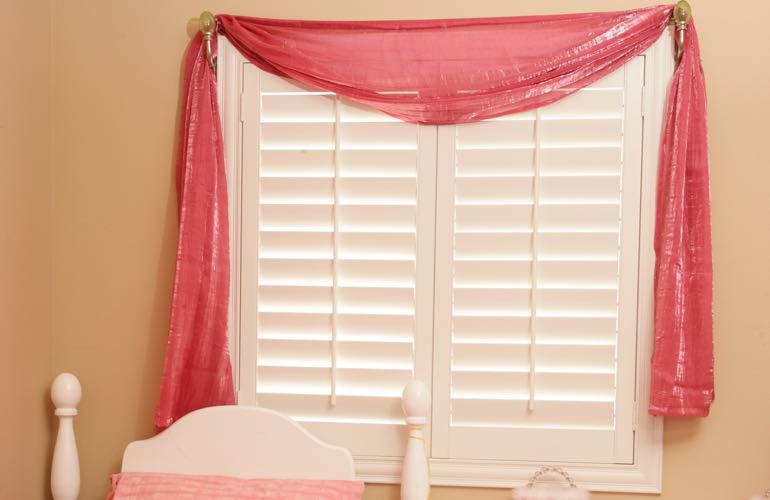 Girl's room with plantation shutters.