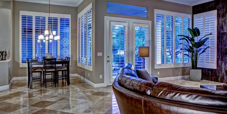 Cleveland great room with plantation shutters and tile floor.