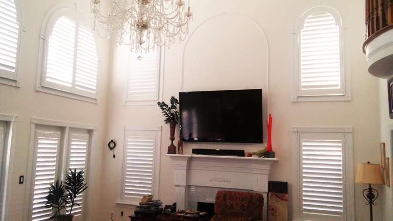 Cleveland great room with mounted television and arc windows.