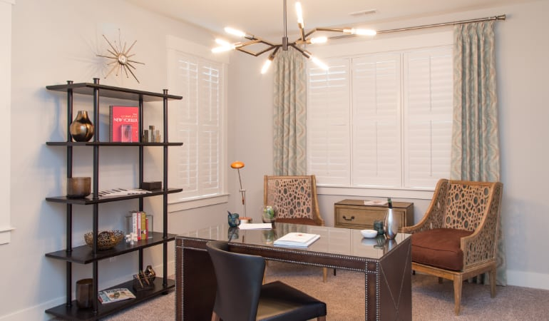 Cleveland home office with plantation shutters.