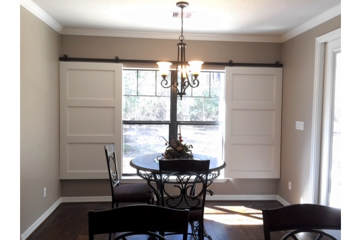 Cleveland dining room with classic barn door shutters.