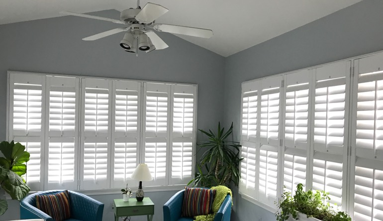 Cleveland sunroom with fan and shutters