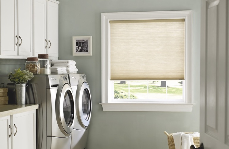Cleveland laundry room with tan window shades.