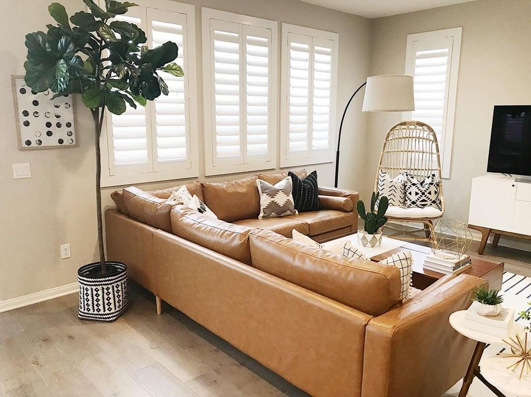 Comfortable living room with our Polywood shutters in Cleveland.