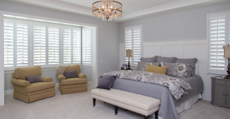 Plantation shutters in Cleveland bedroom.