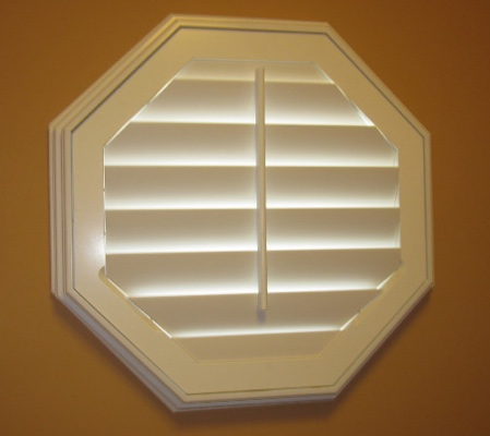 Cleveland octagon window with white shutter