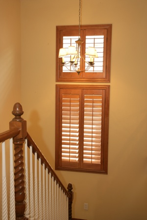 Ovation plantation shutters in tan stairway.