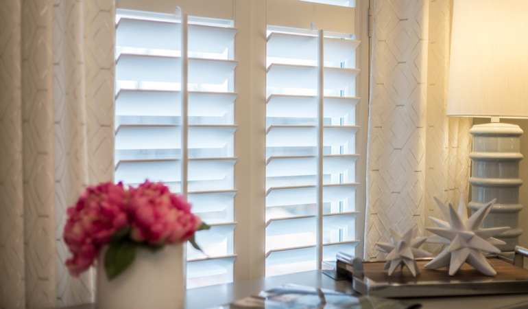 Plantation shutters by flowers in Cleveland