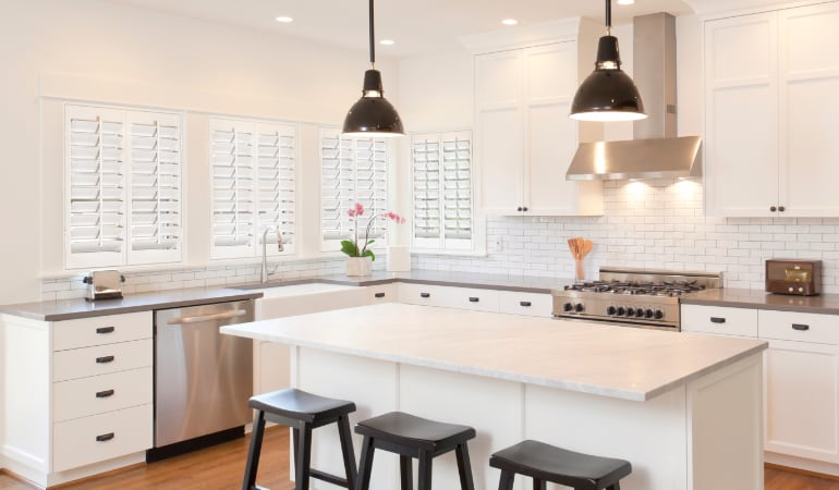 Plantation shutters in a bright Cleveland kitchen.