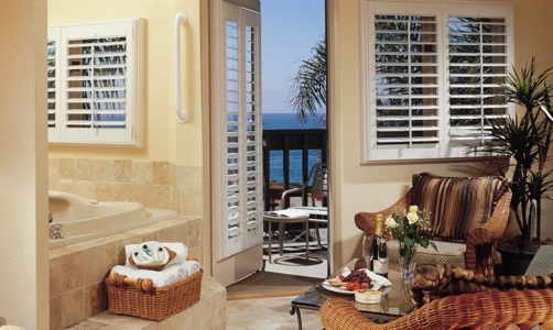 Plantation shutters on casement windows in a tropical home.
