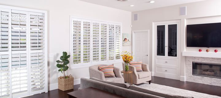 Cleveland living room in white with plantation shutters.