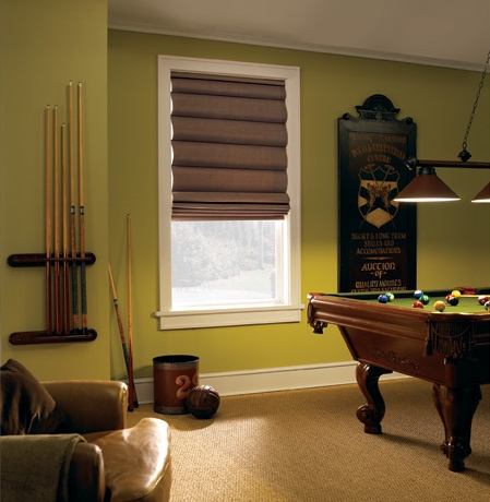 Roman shades in Cleveland pool room with green walls.