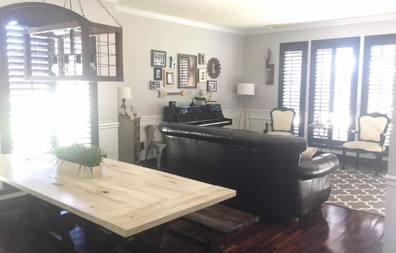 Natural Wood shutters in living room windows by Sunburst Shutters Cleveland.