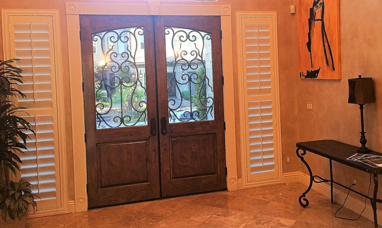 Cleveland foyer door with shutters