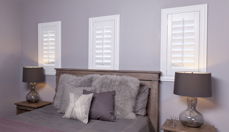 Classic plantation shutters in Cleveland bedroom windows.