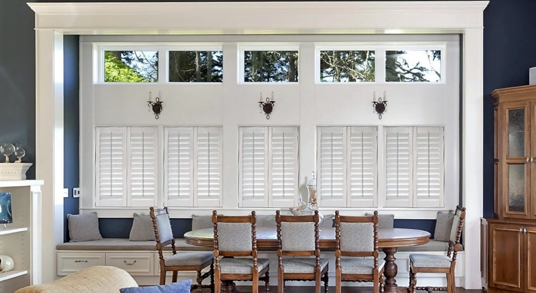Cleveland dining room with white plantation shutters.