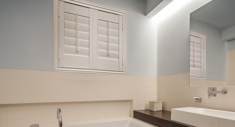 White waterproof shutters in Cleveland bathroom.