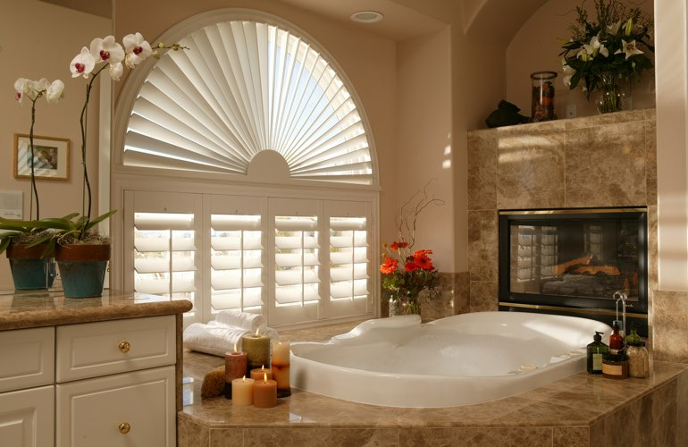 Semicircle shutters in a Cleveland bathroom.