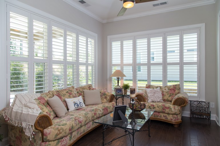 Traditional sunroom with faux wood shutters in Cleveland.