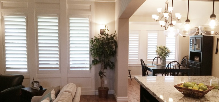 Cleveland shutters in dining room and family room
