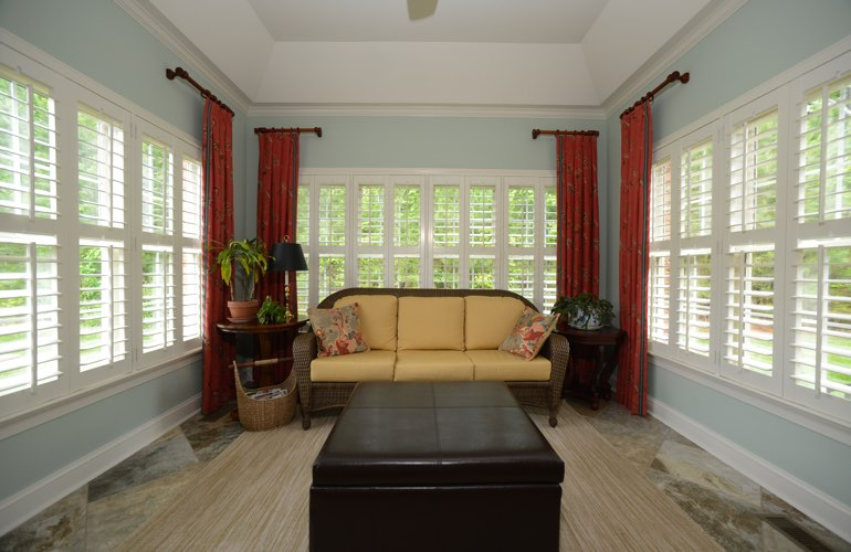 Cleveland sunroom with beautiful window shutters.
