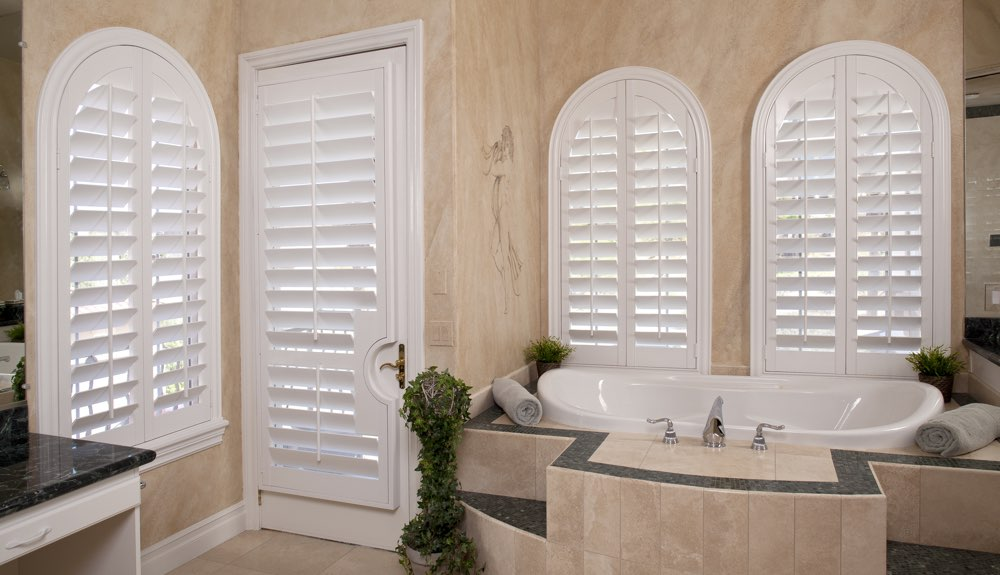 Arched Shutters In A Cleveland Bathroom