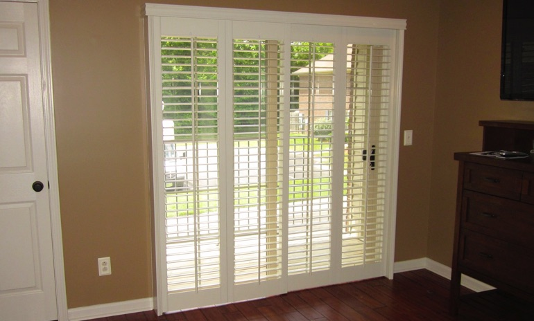 Cleveland sliding door bifold shutters in patio