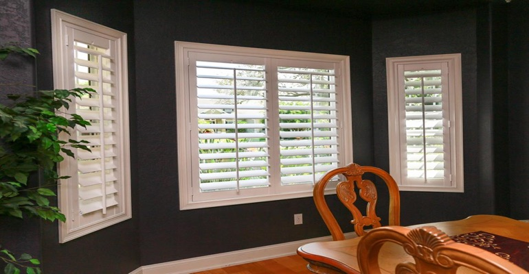 White Plantation Shutters In Dining Room With Dark Paint