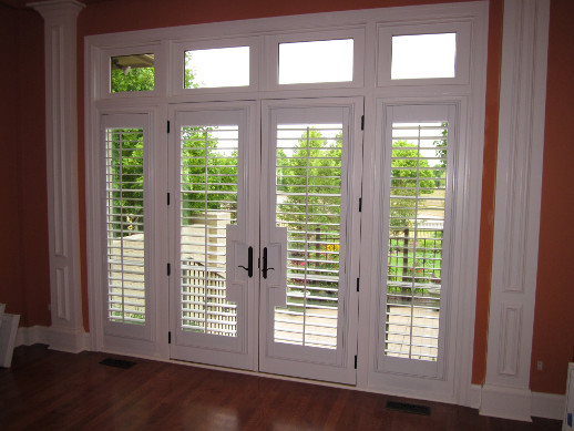 Cleveland patio door with sidelight shutters