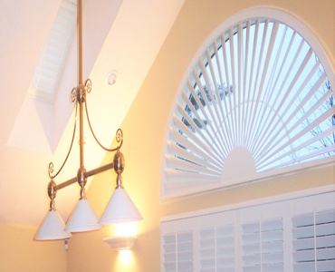 Cleveland arched eyebrow window with plantation shutter