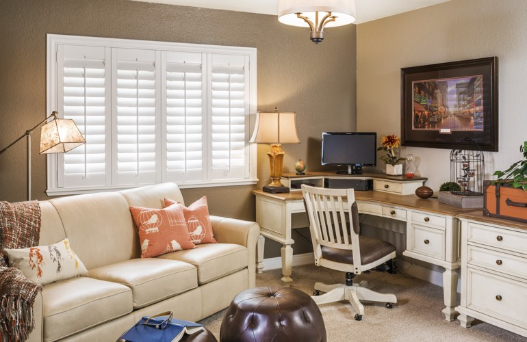 Cleveland home office with plantation window shutters.