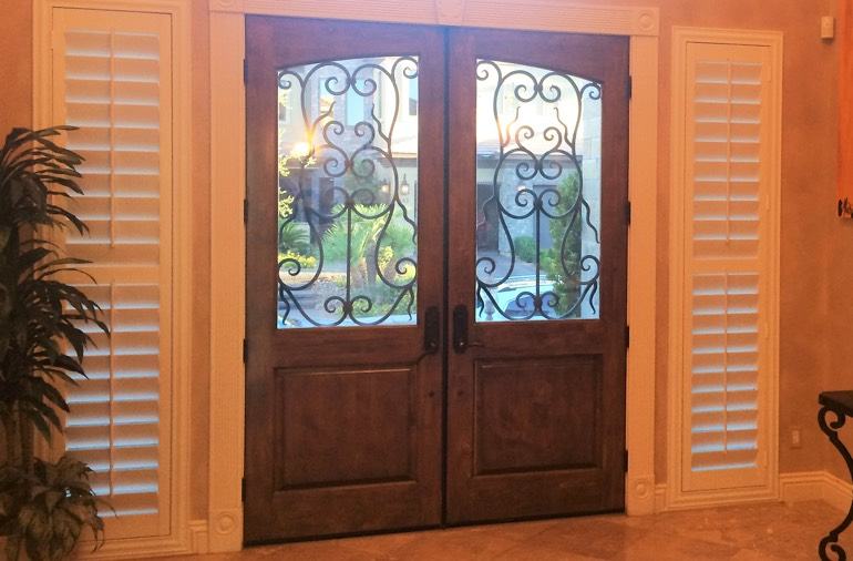 Sidelight window shutters in Cleveland entryway