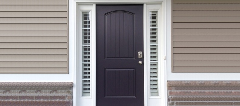 Entry Door Sidelight Shutters Next To Black Door In Cleveland, Ohio