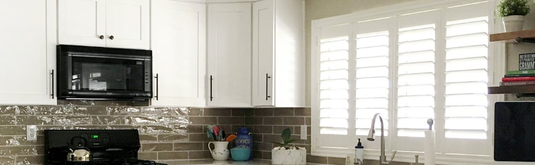 Plantation shutters over a sink